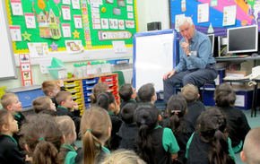 Alec telling stories to a Wembrook Year 1 Class